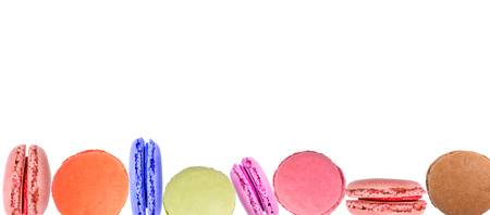 Cake macaron or macaroon on white background from above, colorful almond cookies, top view