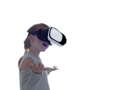 Girl using a virtual reality headset . Isolated on white background Stock Photo