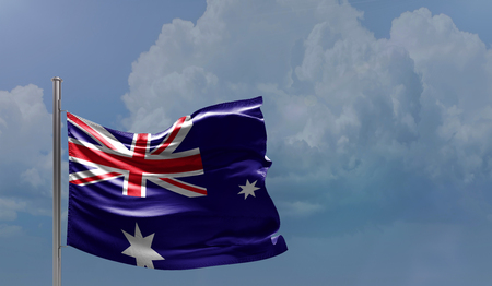 Flag of Australia on cloudy sky