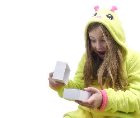 Happy, emotional girl in pajamas received a smartphone as a gift. Isolated on White background