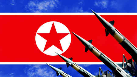 Nuclear missiles and North Korea flag in background. Nuclear bomb concept Stock Photo