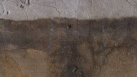 Texture of plaster on the wall. Wall with peeling plaster, grunge background for design