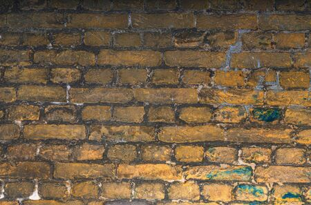 Old stone wall background. Background with Old Vintage Dirty Brick Wall, Texture. Shabby Building Facade Banque d'images - 133066597
