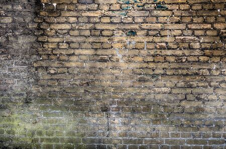 Old stone wall background. Background with Old Vintage Dirty Brick Wall, Texture. Shabby Building Facade Banque d'images - 133066882