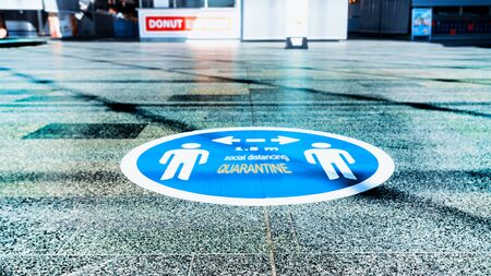 The blue sticker on the floor in shopping centrum as a practicing of the Social Distance during the Covid-19 pandemic 스톡 콘텐츠