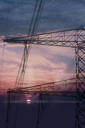 High voltage power lines. Electricity Pylons at Sunset Banque d'images