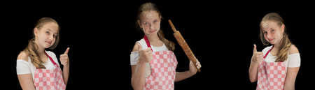Playful young girl with flour on face holding rolling pin and looking at camera isolated on black background. Messy cooking. Archivio Fotografico