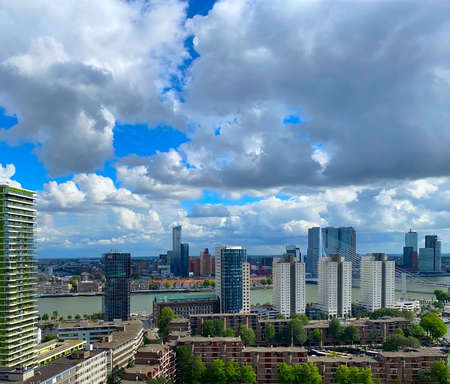 A beautiful and dramatic panoramic shoot of the Rotterdam city skyline with a spectacular dramatic clouds
