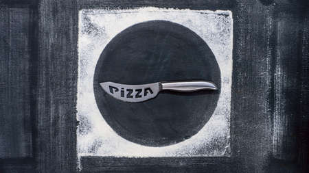 Flour and steel pizza cutter on an old baking sheet. Baking background, copy space for your text, menu, recipe.