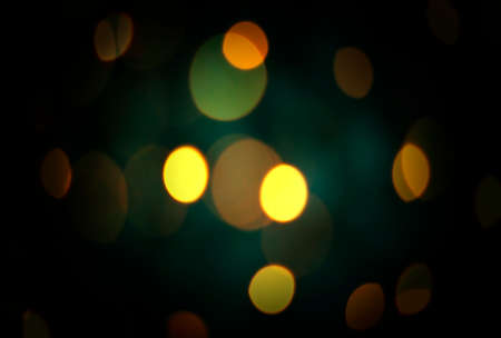 Defocused blurred festive bokeh lights. Blurred garland on Christmas tree as background. New Year and Christmas holidays