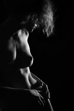 nu:  girl on black background with soft light