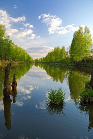 Dream of fisherman. Evening ashore lake photo