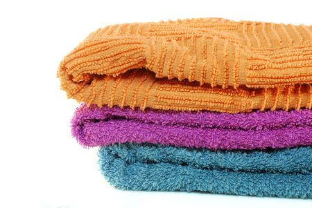 orange washcloth: three comfortable soft colors on a white background, terry cloth bath towel textile Stock Photo