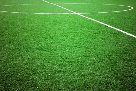 cut grass: football grass background in light and shadow