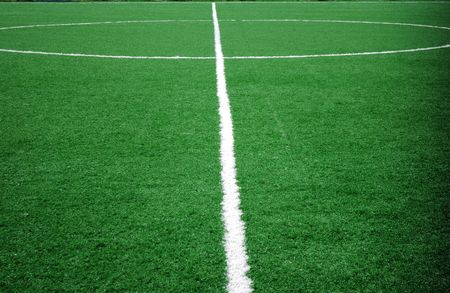 pitch: football grass background in light and shadow