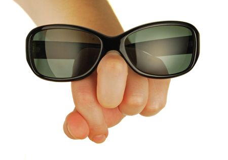 antisun glasses on a womanish hand in form person photo