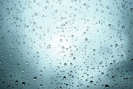 rain drops on a window and mystic silhouette of city Stock Photo - 3627629