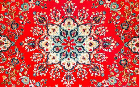 fragment of picture of age-old east carpet. A background is in Persian style
