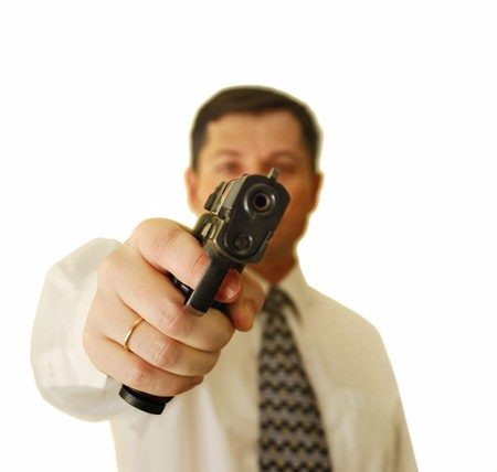 The man in a white shirt and a tie holds a pistol