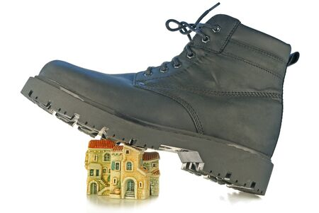 Rough boot on a high thick sole treads on houses photo