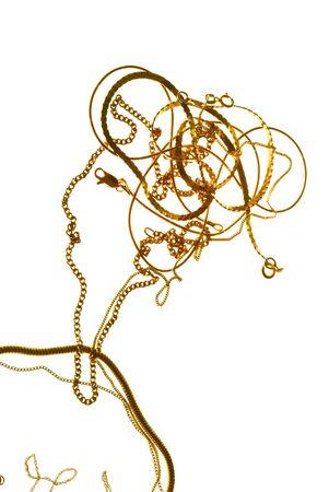 joyas de oro: cadenas de oro se descomponen en figura de forma femenina