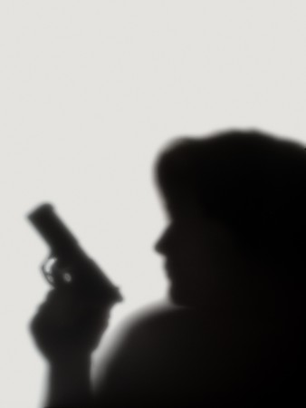 shade of woman  with a pistol on a white background
