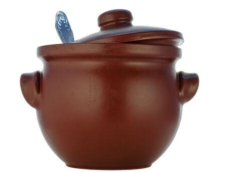 heatproof: brown pot from heatproof ceramics with a spoon Stock Photo
