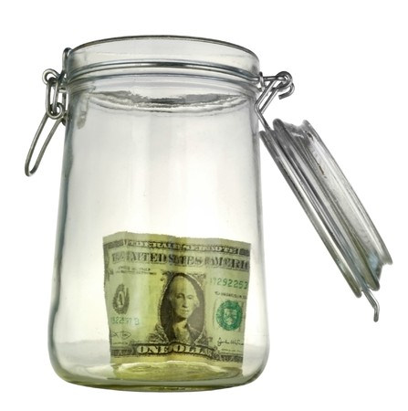 money box in form transparent glass jar photo