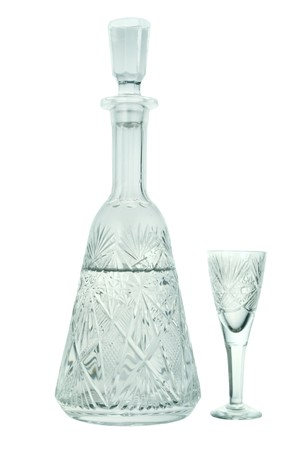crystal carafe with a transparent liquid and wineglass photo