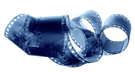 an age-old film is involute chaotically on a white background photo