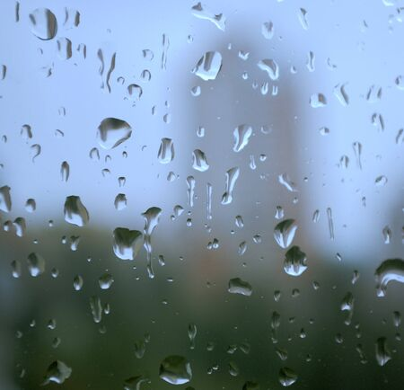 rain drops on a window and mystic silhouette of city Stock Photo - 4534008