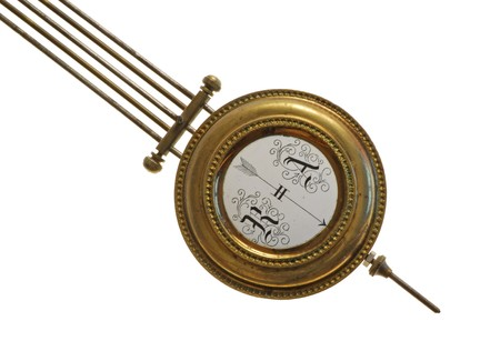 pendulum: the pendulum (detail) of age-old mechanical clock isolated on a white background