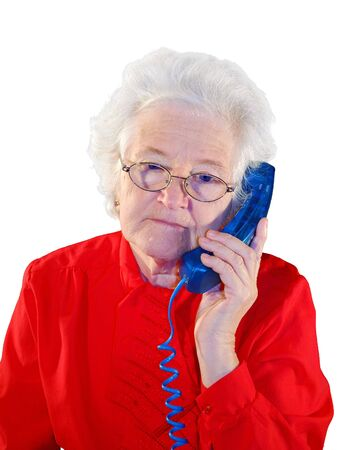 portrait of elderly woman is in red with an dark blue telephone Stock Photo - 4632256
