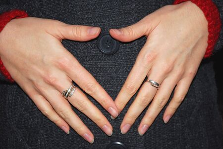 womanish hands touch to the woolen clothes photo