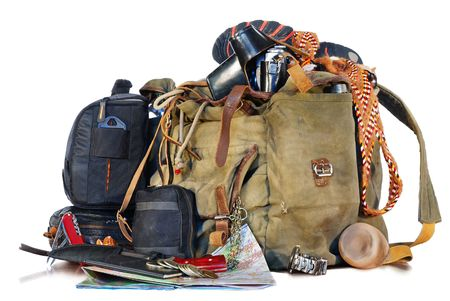 old traveller equipment. backpack, passport, knife, map, camera ets