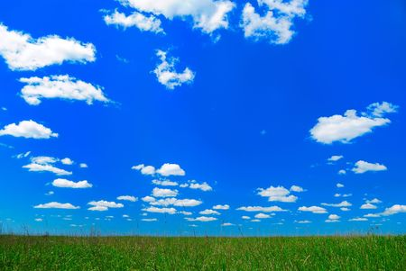 neat: relief picturesque clouds and meadow are in blue sky