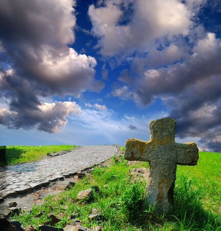 stone cross on the neglected grave in steppe Stock Photo - 5537420