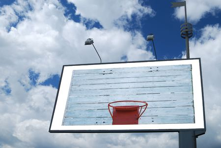 Basketball hoop on empty billboard in sky Stock Photo - 5537306