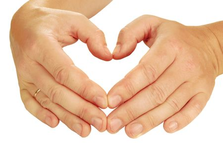 hands built form of heart on a white background photo