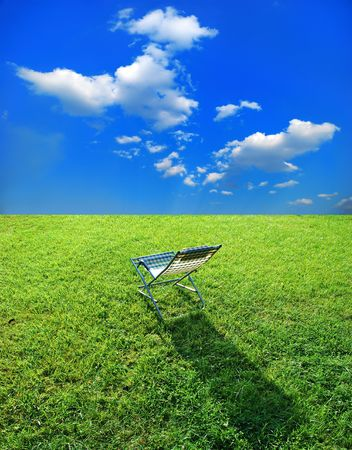 simple chaise lounge on the green grass photo