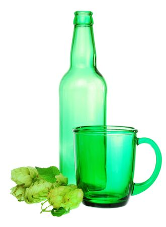 Green bottle, cup and hops on white background photo