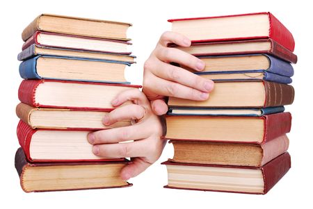 pile of old books and hand on a white background Stock Photo - 5773501
