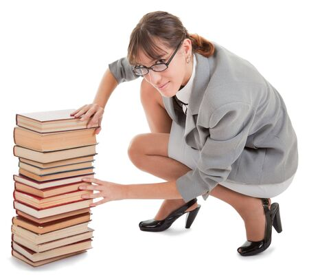 business woman  in spectacles and a pile of books photo