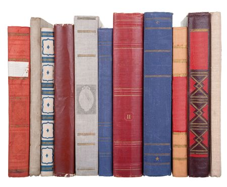 bibliomania: pile of old books on a white background