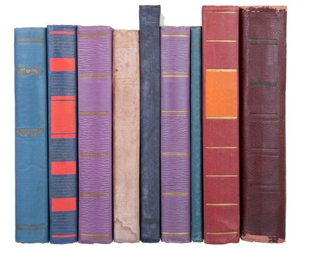 pile of old books on a white background photo