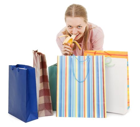 young girl with purchases and banana on white Stock Photo - 6060181