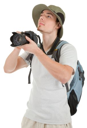 student travel: young man tourist with camera on white