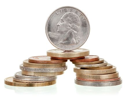 Coins tower on white background photo