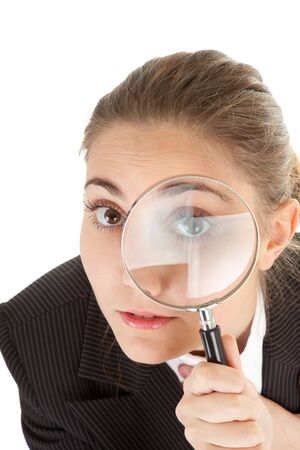 portrait of business woman  with magnifier in hand