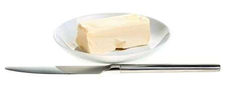 butter knife: piece of butter on a saucer and table knife